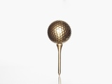 Gold golf ball and tee