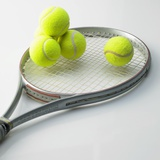 A Tennis Racket and Balls
