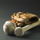 Baseball glove  a bat  and a ball