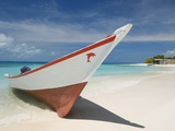 Fishing boat on beach in Los Roques Archipelago National Park