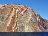 Sedimentary layered mountains on Ymer Island in Greenland