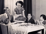 Mother serving a turkey on a platter