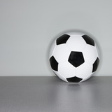 Soccer ball next to wall
