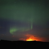 Aurora Borealis over eruption at Eyjafjallajokull glacier