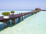 Boardwalk and bungalow by a lagoon in the Maldives