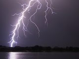 Lightning Striking Ground Near Residential Lake