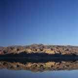 Brown Hills Reflected in a Lake