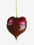 Heart cherry dipped in chocolate sauce