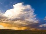 Rain clouds moving across landscape