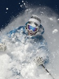 Skier in deep powder snow