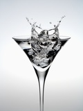 Wineglass of splashing water