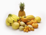 Stack of yellow fruits and vegetables