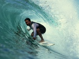 Professional Surfer Riding a Wave
