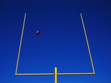 Football Flying Through Goalpost