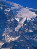 Snow Covered peak of Mount Rainier in the Cascade Mountain Range