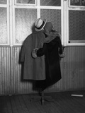 Hanging Coats Posed as an Embracing Couple Papier Photo par Bettmann