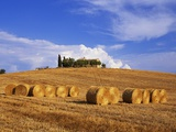Hay Bales and Farmhouse in Val d'Orcia