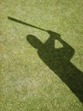 Shadow of Baseball Player Swinging Bat
