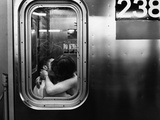 Passionate Couple Kissing in a Subway Car