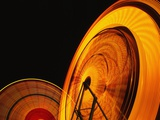 Spinning Ferris Wheels at Night