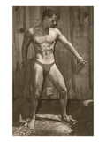 Muscle Man Posing by Wood Fence