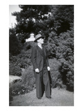 Man in Three-Piece Suit Standing in Garden