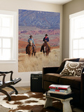 Cowboy and Cowgirl Riding Through Scenic Hills of the Big Horn Mountains  Shell  Wyoming  USA