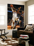 Denver Nuggets v Charlotte Bobcats: DJ Augustin and Nene