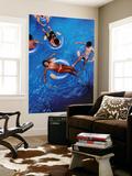 People Floating in Pool on Rubber Rings