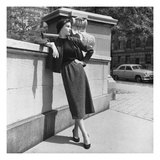 Vogue - October 1952 - Model Leans on Stone Wall
