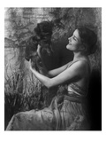 Vanity Fair - April 1921 - Woman Holding a Pekingese Dog Aloft