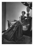 Vogue - December 1934 - Woman in Maggy Rouff Gown on Sofa