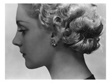 Vogue - February 1934 - Blonde Woman Wearing Spiral Clip Earrings