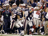 New York Giants and New England Patriots - Super Bowl XLVI - February 5  2012: Mario Manningham