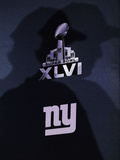 New York Giants and New England Patriots - Super Bowl XLVI - February 5  2012: Eli Manning's shadow