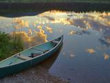 Canoeing on Rainy Lake at Sunset in the Lolo National Forest  Montana  Usa