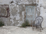 Old Building Chair and Doorway in Town of Oia  Santorini  Greece