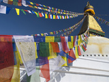 Prayer Flags Flutter from the Apex of Bodnath Stupa  Kathmandu  Nepal