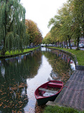 Canal with Boats in Small Town of Edam  Netherlands