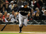 Scottsdale  AZ - March 10: Mariners v Diamondbacks - Munenori Kawasaki and Takashi Saito