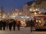 Christmas Market Stalls and People at Marktstrasse at Twilight  Bad Tolz Spa Town  Bavaria  Germany