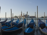Moored Gondolas and the Island Church of San Giorgio Maggiore  Venice  Veneto  Italy