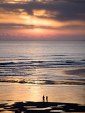 Man and Woman in Silhouette Looking Out Over North Sea at Sunsrise From Alnmouth Beach  England