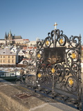 St John of Nepomuk Shrine at Charles Bridge with Prague Castle and Mala Strana in Background