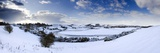 Snow-Covered Landscape Beneath Blue Winter Sky Looking Towards Meandering River Aln  England