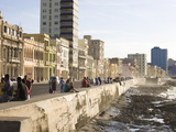 View Along the Malecon  People Sitting on the Seawall Enjoying the Evening Sunshine  Havana  Cuba