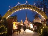 Sign Over Gate and Stalls  Christmas Market (Christkindlmarkt) on Kapellplatz Square  Bavaria