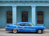 Old Blue American Car With Body Repairs Parked in Front of Blue Dispensary  Havana Centro  Cuba