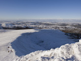 Hikers on Snow Covered Pen Y Fan Mountain  Brecon Beacons National Park  Powys  Wales