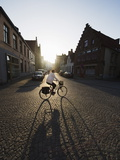 Sunset and Shadow of a Cyclist on Cobbled Street  Old Town  UNESCO World Heritage Site  Bruges